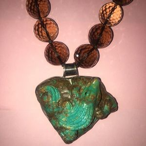 Turquoise alligator on a smoky quartz necklace.